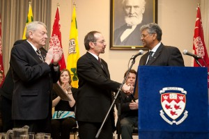 Under the watchful eye of the Founder himself, Macdonald Campus Award of Excellence for Administrative and Support Staff winner Luciano Germani is congratulated by McGill Chancellor Richard Pound (left) and Dean Chandra Madramootoo (right). / Photo: Claudio Calligaris.