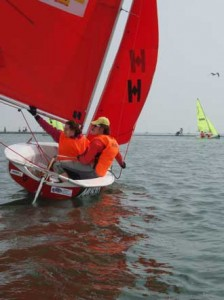 Sailors Valerie Simonis and Austin Milne manned one of the three McGill boats competing for Team Racing supremacy at the 59th annual Wilson Trophy championships in West Kirby, England last spring. / Photo courtesy McGill Sailing Team