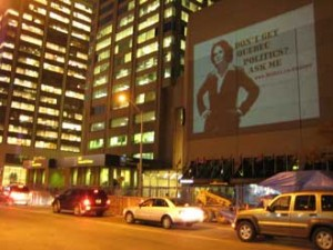 An image of Professor Antonia Maioni is projected on a building in Toronto as part of the McGill in Six Words campaign.