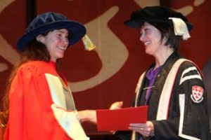 Maggie Kilgour receives her award for Excellence in Teaching from Principal Heather Munroe-Blum. / Photo: owen Egan