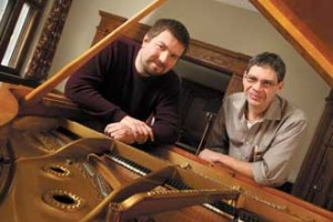 Chris Smythe (left) and Kerry Wagner rely mostly on their ears to determine when a piano is in tune. / Photo: Owen Egan