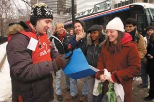 Welcoming with open (house) arms: AMcGill alumnus greets students from Quebec City at Open House 2008. / Photo: Owen Egan