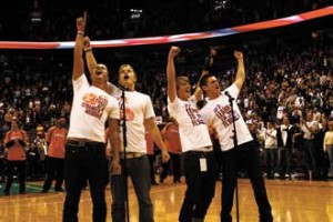 From left to right: Ben Nemtin, Duncan Penn, Jonnie Penn (a McGill History undergrad) and Dave lingwood of the Buried Life project hit the last note of O Canada in front of 20,000 screaming fans prior to an NBA exhibition game. The stunt enabled them to cross #35 off their Things To Do Before We Die list. / Photo: Kyle Jewell