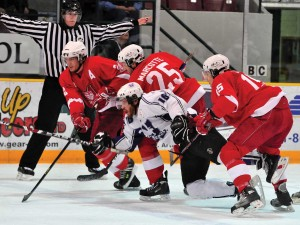 Charge of the Redmen light brigade (L to R): Linemates Guillaume Doucet, Simon Marcotte-Legare and Eric L'Italien charge across the blueline in McGill's 4-3 victory over Western at the CIS men's hockey championship tourney. / Photo courtesy of Lakehead University
