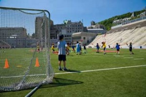 A group of young campers plays a game of Canada's official summer sport, lacrosse, at Molson Stadium. Between 1,000 and 1,200 attend the McGill sports camp every summer.