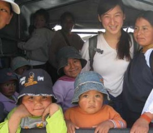 Andrea Evans in the back of a truck with children and mothers of Chilcapamba, Ecuador. / Photo courtesy of Andrea Evans.