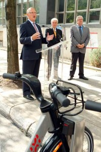 Montreal Mayor Gérald Tremblay announces creation of a new bicycle path as François R. Roy, Vice-Principal (Administration and Finance) and André Lavallée, Vice-Chairman of the Executive Committee look on. / PHOTO: Owen Egan