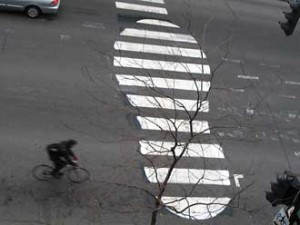 "With his urban art, Peter ""Roadsworth"" Gibson tries to add a little life to the city's otherwise cold and grey landscape. Here, he gets creative with a common crosswalk. Photo courtesy of Roadsworth."