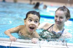 Five-year-old Zakaria Tou enjoys some pool time with McGill Physiology undergrad and Making Waves instructor, Laura Machan. / PHOTO: Michael Garfinkle