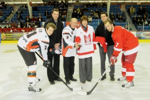UQTR Rector Ghislain Bourque and McGill Principal Heather Munroe-Blum (sporting their respective team jerseys), presided over the ceremonial opening faceoff at the game between the UQTR Patriotes and the visiting McGill Redmen at Le Colisée in Trois-Rivières Friday night. / Photo courtesy UQTR