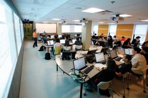 Prof. Nigel Roulet and the students in his Environmental Systems Modelling course are big fans of BH-511, a recently renovated classroom in Burnside Hall. The room features powerful computers for each of the 38 students it can accommodate, as well as a central console from which the lecturer can take control of a student's computer and project it onto six large screens. / Photo: Owen Egan